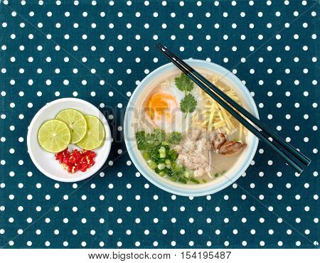 Rice porridge with mined pork and chicken lever served  spicy sour filling.