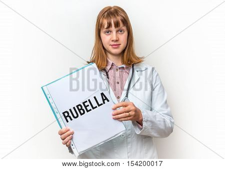 Female Doctor Showing Clipboard With Written Text: Rubella