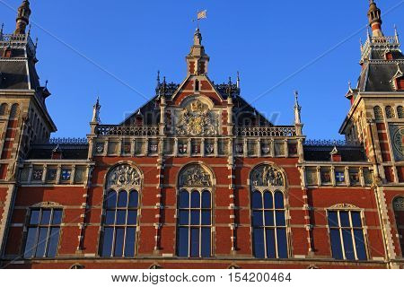 Amsterdam Central Train Station(Centraal) in Amsterdam, Netherlands. Sunset light
