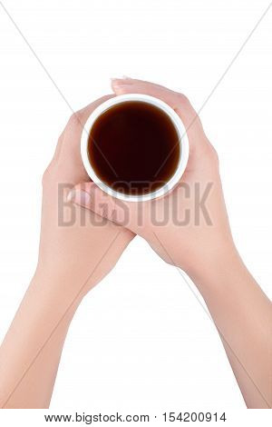 hands holding white paper cup of tea or coffee isolated on white background top view. Woman holds a disposable cup over white background. Female's hands with paper cup top view