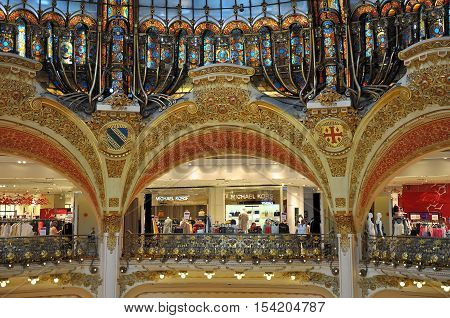 PARIS FRANCE - JULY 2: Decorated walls of Lafayette department store on July 2 2015 in Paris France. The Galeries Lafayette is the most famous department store in Paris.