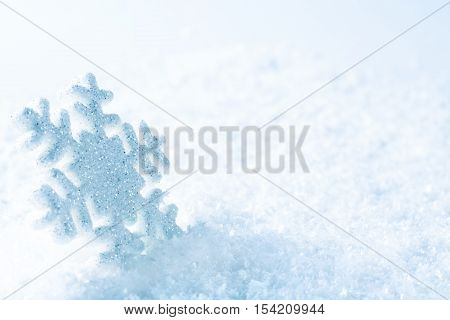 Snowflake on Snow Blue Sparkles Snow Flake Abstract Winter Background