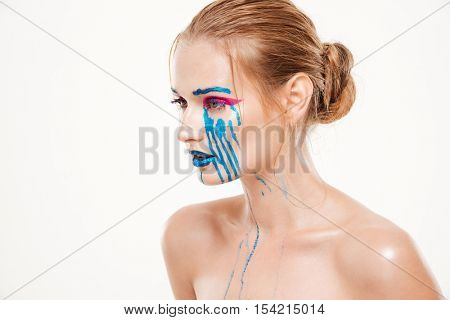 Beautiful woman with blue tears. Color make up. colorfully. stands sideways