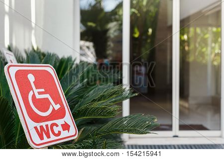 red sign of toilet for wheelchair users. all inclusive hotel with attention to persons with disabilities.