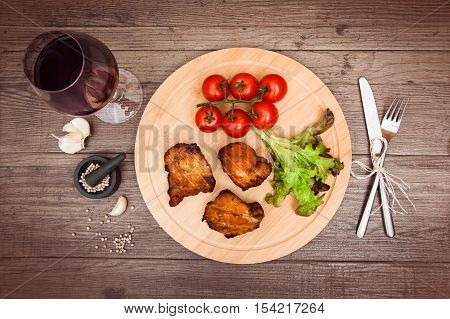 Succulent Pieces Of Grilled Pork Fillet Served With Cherry Tomatoes.