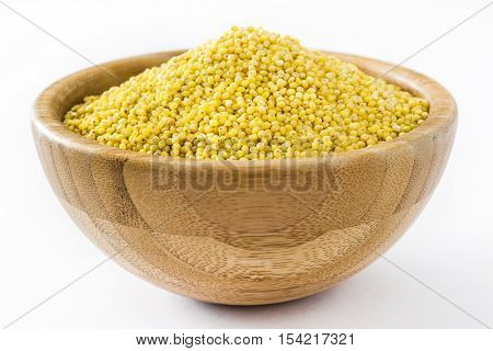 Organic millet seeds isolated on white background