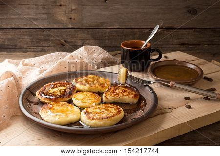 Cottage Cheese Pancakes With Honey On Brown Ceramic Plate