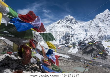 Beautiful Landscape of  Everest and Lhotse peak with colorful Nepali flag as foreground from Kala Pattar view point. Gorak Shep. During the way to Everest base camp. Sagarmatha national park. Nepal.
