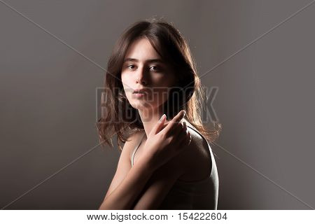 Fashionable Woman On Dark Grey