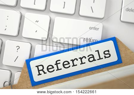Referrals. Orange Sort Index Card Lays on Modern Laptop Keyboard. Archive Concept. Closeup View. Blurred Illustration. 3D Rendering.