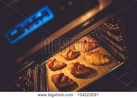 Croissant Electric Oven Baking. Tasteful Croissant Buttery Pastry.
