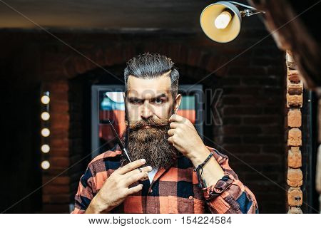 Bearded Man With Scissors