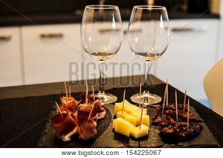 aperitif for two with finger food, speck and cheese at the buffet