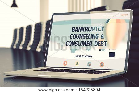 Modern Meeting Hall with Laptop Showing Landing Page with Text Bankruptcy Counseling and Consumer Debt. Closeup View. Blurred Image with Selective focus. 3D.