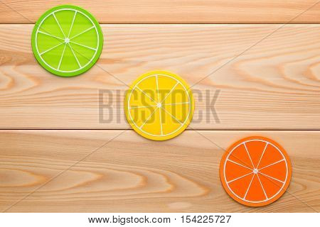 Three Multi-colored Cups Stand In The Form Of Orange Slices