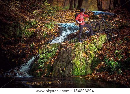 Scenic Bike Trip During Autumn Foliage. Caucasian Mountain Biker.