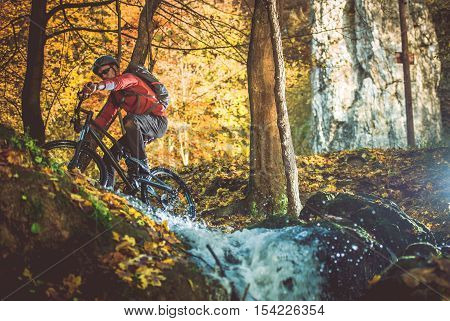 Scenic Forest Bike Trail. Fall Foliage Biking. Caucasian Men on the Bike Trip.
