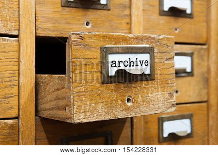 Archive system concept photo. Opened box archive storage, filing cabinet interior. wooden boxes with index cards. library service information management.