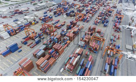 Cargo containers at seaport in aerial view