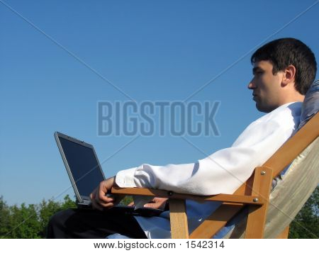 Businessman Working Amongst Nature