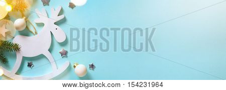Christmas holidays decoration and tree light on blue background