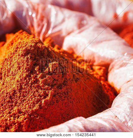 Harissa tunisian spice mixture with red chili pepper salt and garlic in sack at a farmers market