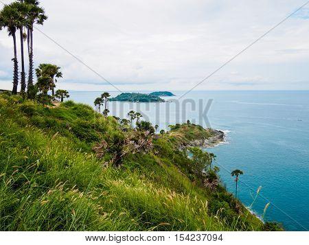 hill tree sea ocean white sky at Phromthep Cape phuket Thailand