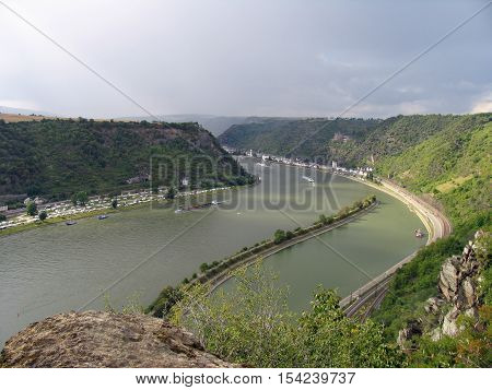 Picturesque landscape of Middle Rhine. View from above from Lorelei rocks at St. Goarshausen, Katz Castle. The Rhine (Latin: Rhenus, Romansh: Rein, German: Rhein, French: le Rhin) is a European river. The Rhine Gorge is a popular name for the Upper Middle