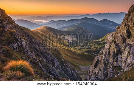 Mountain Landscape in Colourful Sunset. View from Mount Dumbier in Low Tatras Slovakia. West Tatras Mountains in Background.
