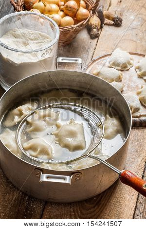 Freshly cooked homemade dumplings on old wooden table