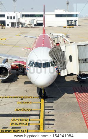 Airplane with the gangway - Stock Photo