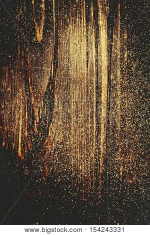 Wooden textured background with colden glitter. close