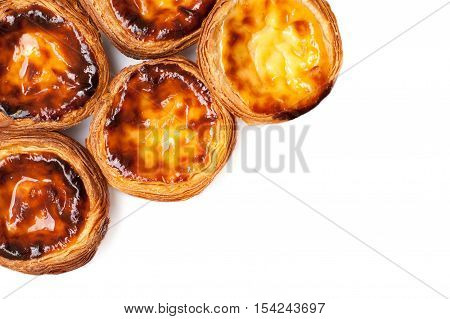 Egg Tarts isolated on white background. Heap of Typical portuguese dessert pasteis de nata close up