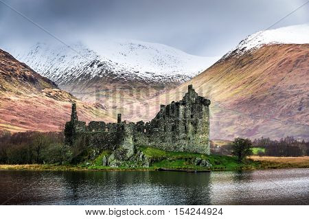 Old and abandoned Kilchurn Castle in winter, Scotland