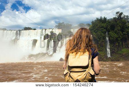 Girl Tourist Looking At The Iguassu Falls