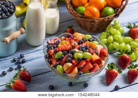 Healthy salad made ​​of fresh fruits on wooden table