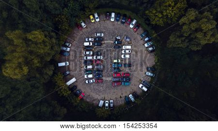 Car parking lot viewed from above, Aerial view. Top view. Parking in the woods in the form of a circle. Concept