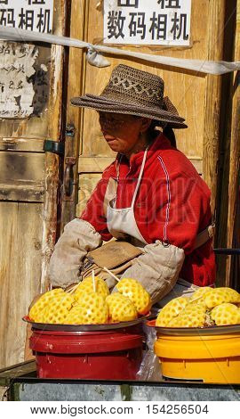 Chinese Vendor Selling Fresh Fruits On Street
