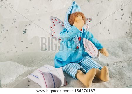 Soft Textile Doll In Blue Pajamas And A Pillow