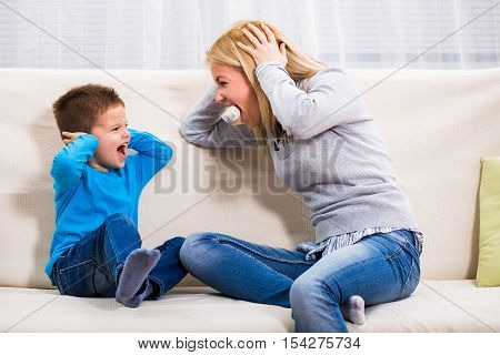 Mother and son are shouting on each other.