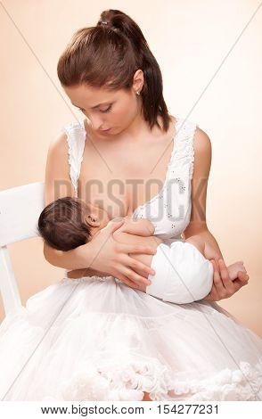 young beautiful mother breast feeding her child