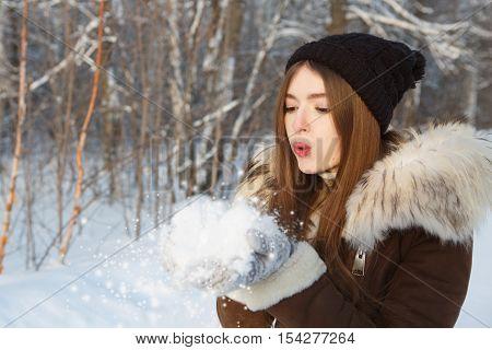 Beauty Winter Girl Blowing Snow In Frosty Park.