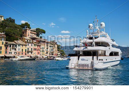 PORTOFINO, ITALY - AUG 7, 2016: Bay with boats at Portofino in Liguria, famous Mediterranean sea town at the Italian Riviera.