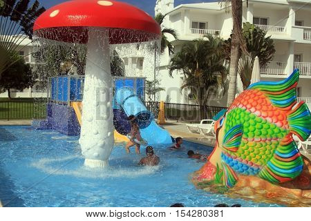 Negril Jamaica - October 15 2016. Happy kids having fun in the pool beach resort in Negril Jamaica.