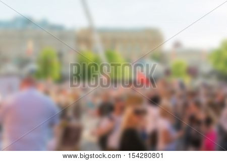 Large crowd parade theme creative abstract blur background with bokeh effect