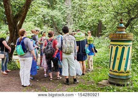 MOSCOW, RUSSIA - JUN 18, 2016: People during excursion in Izmailovskaya apiary on summer day. Izmailovskaya experimental apiary has century and a half history.