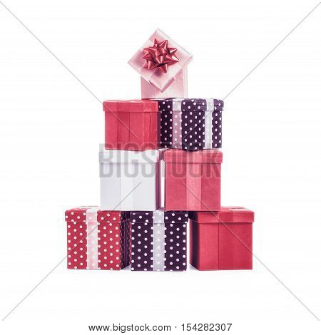 Stacked gift boxes with ribbon bow. Christmas present. Croup of objects isolated on white background