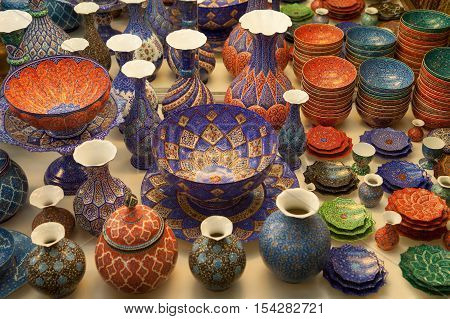Handmade copper vases plates and bowls handcrafted with colorful Persian enamel called Mina traditionally made in Isfahan Iran.