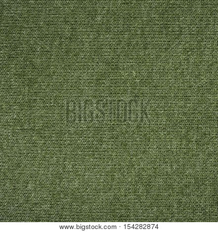 Green knitwear fabric texture. Fashion fabric texture background
