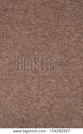 Brown knitwear fabric texture. Fashion fabric texture background